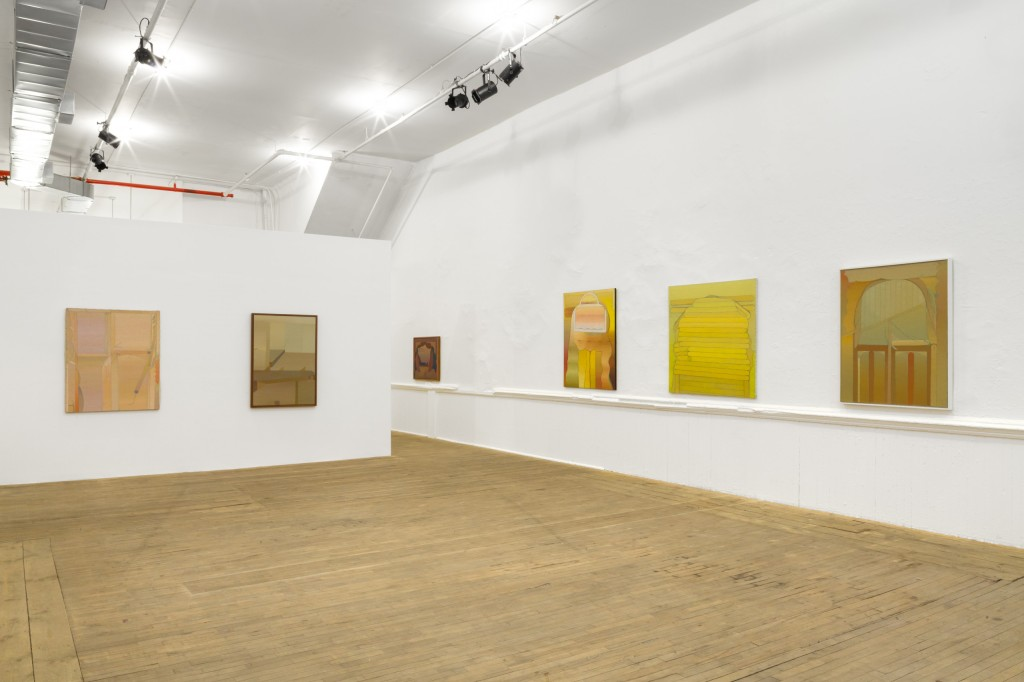 Six paintings are hung on white walls at eye level. The paintings contain muted and vibrant warm colors depicting abstract shapes.